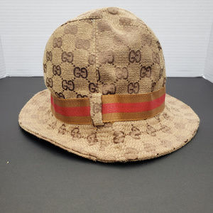 Gucci bucket hat with bronze and red ribbon accent